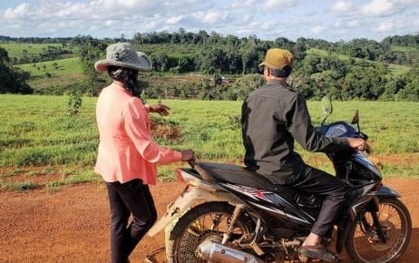 Two local residents in Mondulkiri province's O'Reang district point out villagers' farms falling within the potential bounds of a new airport development.
