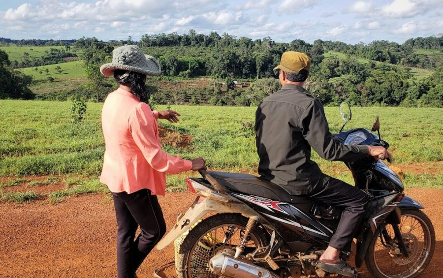 Two local residents point out villagers' farms falling within the potential bounds of a new airport development in Mondulkiri province. (Danielle Keeton-Olsen/VOD)
