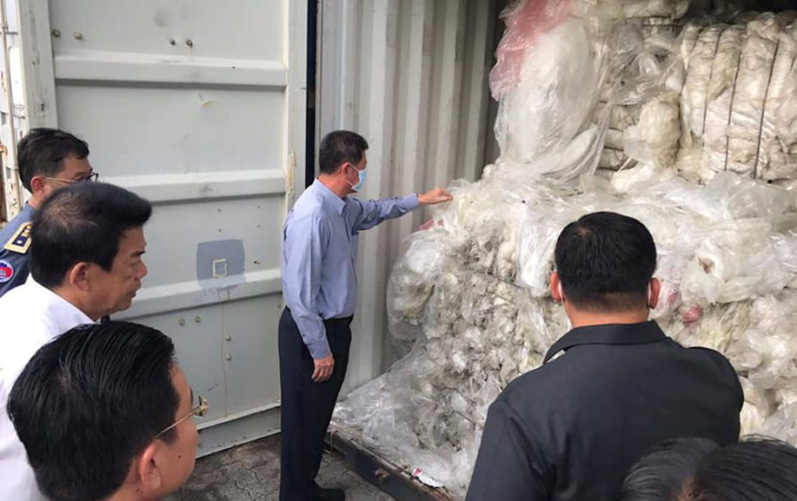Officials unveil a container full of plastic trash in Sihanoukville in July 2019.
