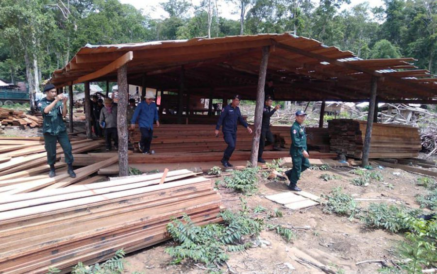 Members of an anti-forestry crimes task force inspect illegal timber in Mondulkiri province's Koh Nhek district on July 16, 2019. (National Military Police)