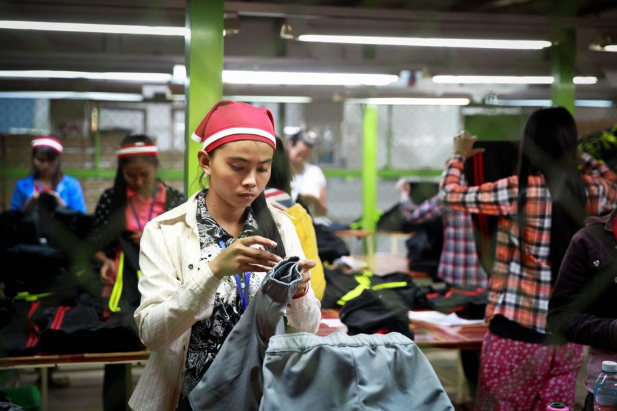 Garment workers in a factory in Cambodia on December 9, 2014. (ILO)