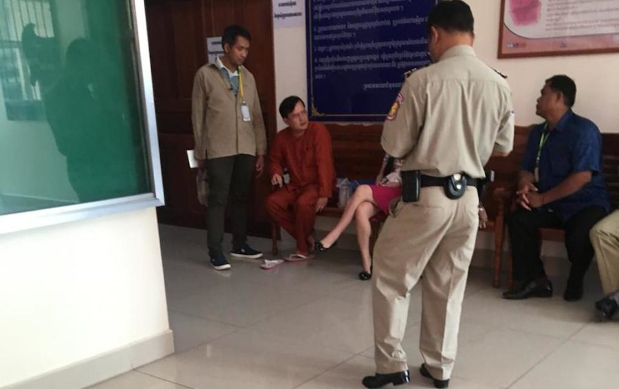Lay Vannak, in orange, at the Phnom Penh Municipal Court on August 22, 2019. (VOD/Khan Leakhena)