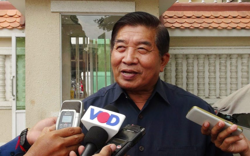 Ahmad Yahya, former secretary of state at the Social Affairs Ministry, speaks with journalists outside the Phnom Penh Municipal Court in this file photo.