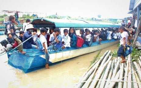 Children leave the floating Kbal Taol Primary School in Battambang province's Koh Chivaing commune by boat.