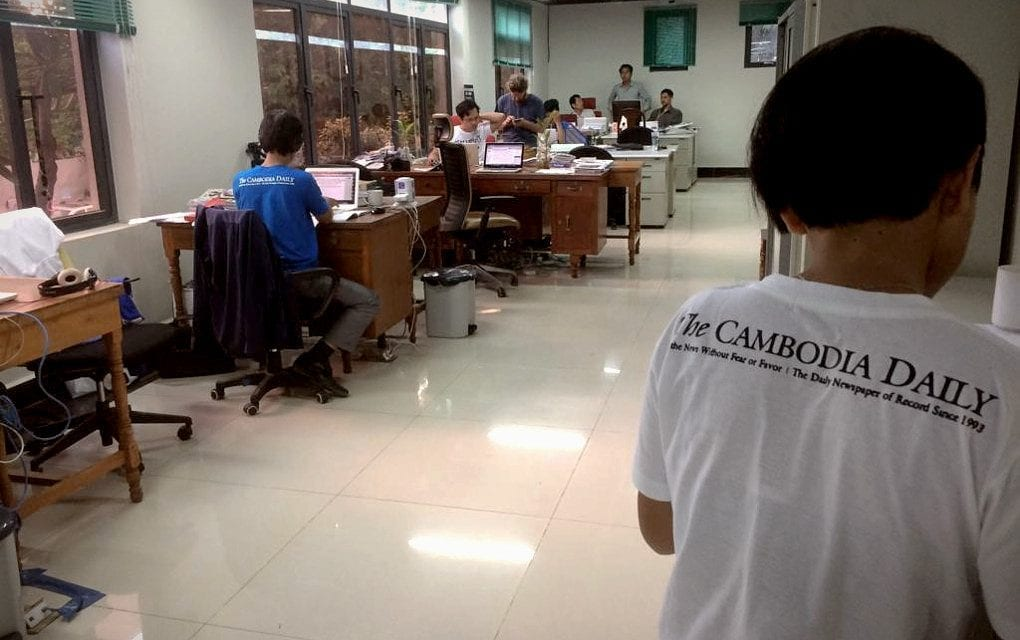 Journalists working on the final issue of the Cambodia Daily in the newsroom in Phnom Penh on September 3, 2017 (Ananth Baliga)