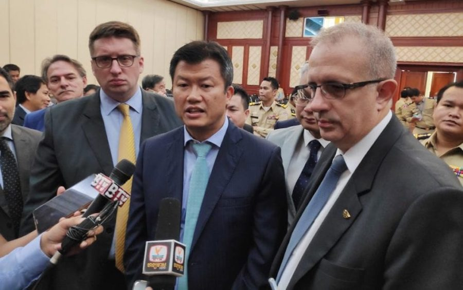 Meach Sophanna, president of the Counter Counterfeit Committee of Cambodia (center), and Arnaud Darc, chairman of EuroCham (right), speak with reporters following the signing of an MoU pledging to combat the proliferation of counterfeit goods in Cambodia on September 12, 2019. (Vann Vichar/VOD)