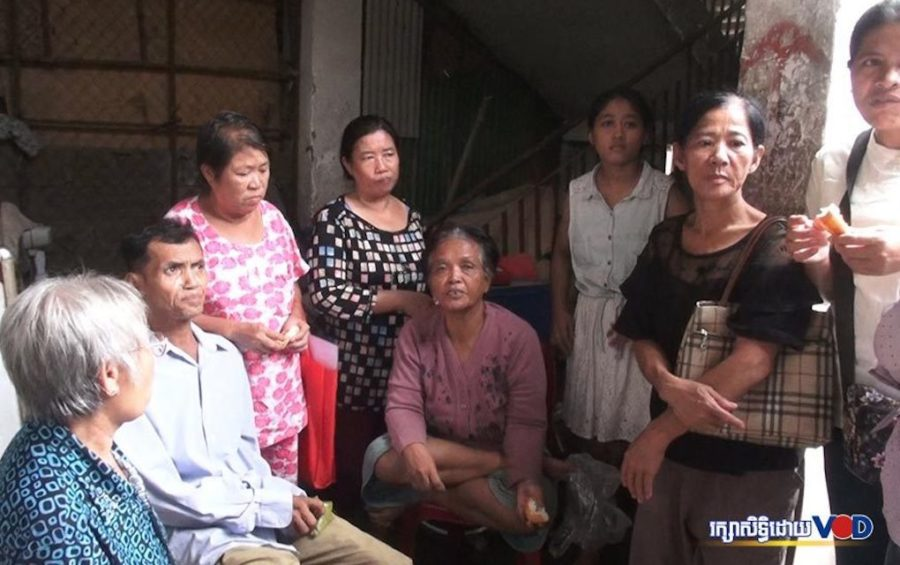 Borei Keila residents stand in the stairwell that has become their new home, on September 18, 2019. (Hy Chhay/VOD)