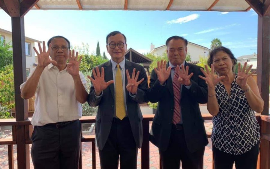 CNRP leaders Sam Rainsy and Ho Vann (third and second from the right) raise nine fingers along with other CNRP supporters in the U.S. on September 23, 2019 (CNRP activist's Facebook page)