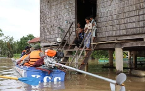 Officers in Kratie province check on families affected by flooding in September 2019. (National Committee for Disaster Management)