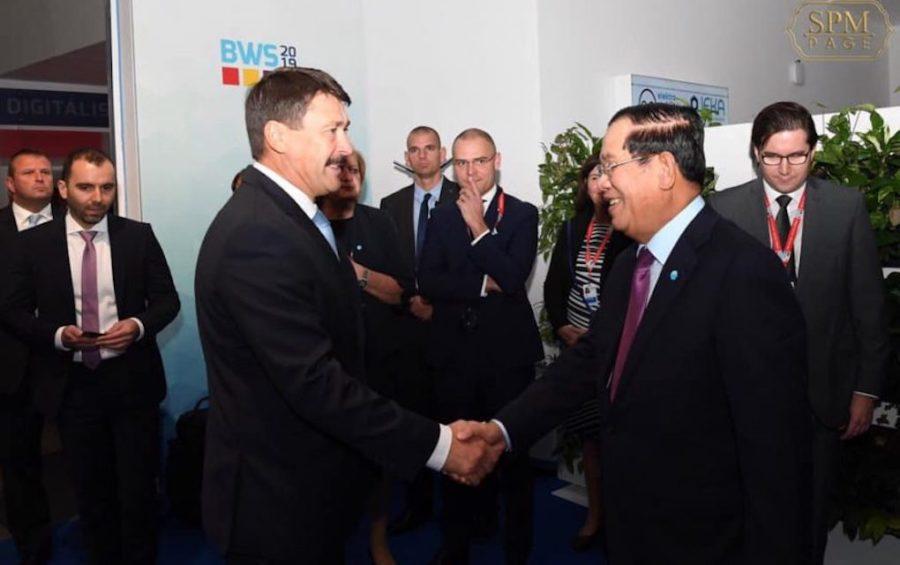 Hungarian President Janos Ader and Prime Minister Hun Sen shake hands during a state visit to Hungary on October 15, 2019, in a photo posted to Hun Sen's Facebook page.