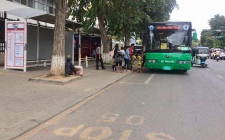 A city bus picks up passengers in front of Ang Doung Hospital on Norodom Blvd, Phnom Penh, on October 18, 2019. (Chhorn Sopheap)