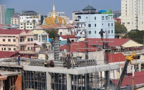 Construction workers at a building site in Phnom Penh in January 2015 (Philip Brookes/Flickr)