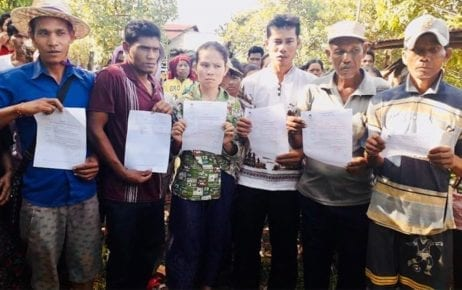 Six representatives of Koh Kong villagers engaged in a land dispute with Heng Huy Agriculture Group hold up their court summonses on November 27, 2019. (Supplied)