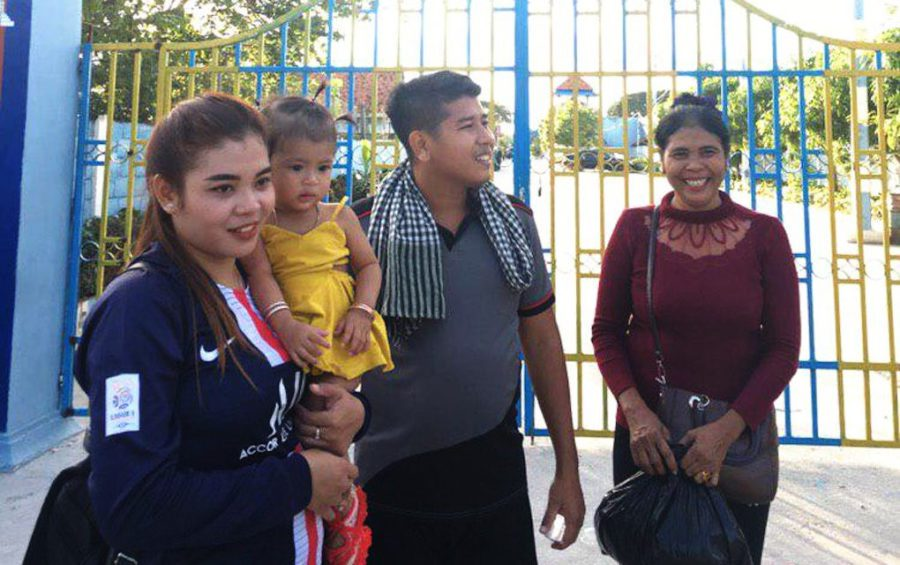Activist Kung Raiya upon his release on bail from Prey Sar prison in Phnom Penh on November 29, 2019, with his wife holding their daughter (Supplied)