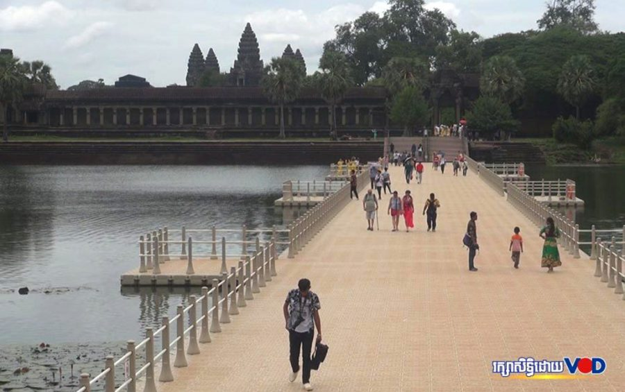 People visit Angkor Wat in Siem Reap province.