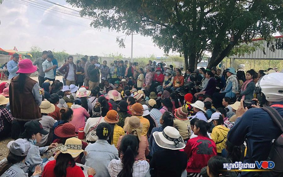 Glove factory workers gather in Kandal province on December 23, 2019. (Khut Sokun/VOD)