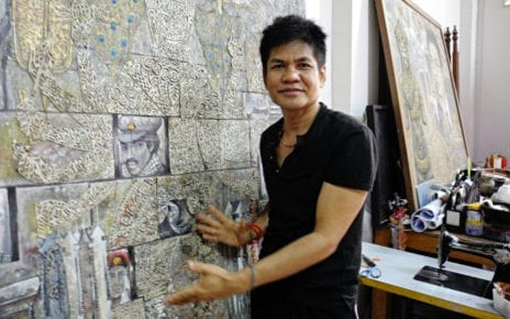 Leang Seckon in his studio in Phnom Penh explains one of his works. (Michelle Vachon)