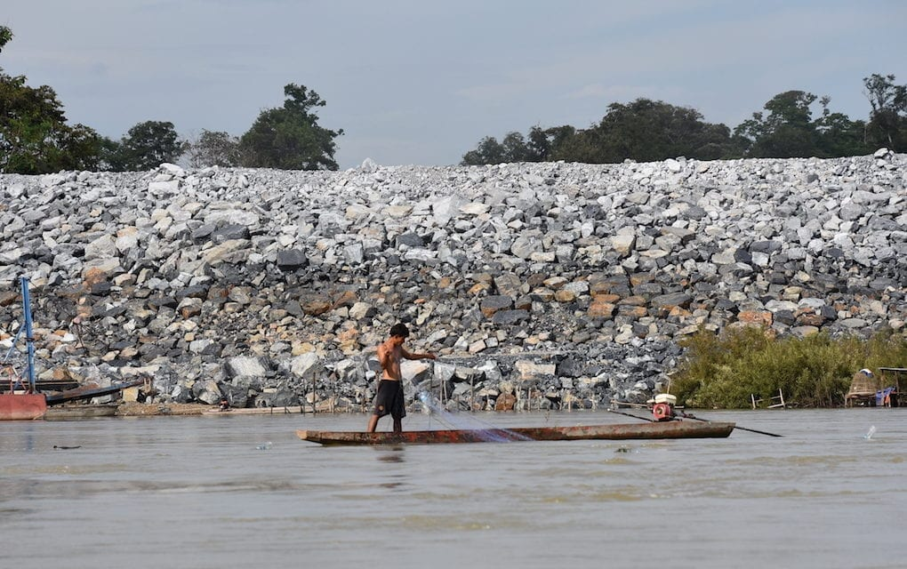 A fisherman in front of the Don Sahong cofferdam in Laos in 2016 (International Rivers)