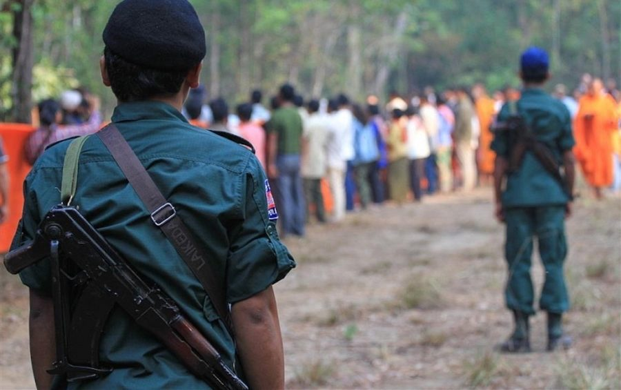 Armed police monitor participants of a tree blessing ceremony in Prey Lang protected forest in 2019 (Licadho)