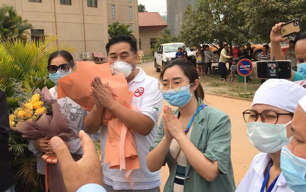 Chinese man Jia Jianhua, who had tested positive for novel coronavirus in January, gestures after being discharged from quarantine at Preah Sihanouk provincial hospital, in this photograph posted to the Health Ministry's Communicable Disease Control Department's Facebook page on February 10, 2020.