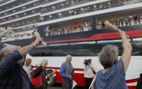 Passengers of the Holland America Line's Westerdam cruise ship wave in Sihanoukville on February 14, 2020. (Panha Chorpoan/VOD)