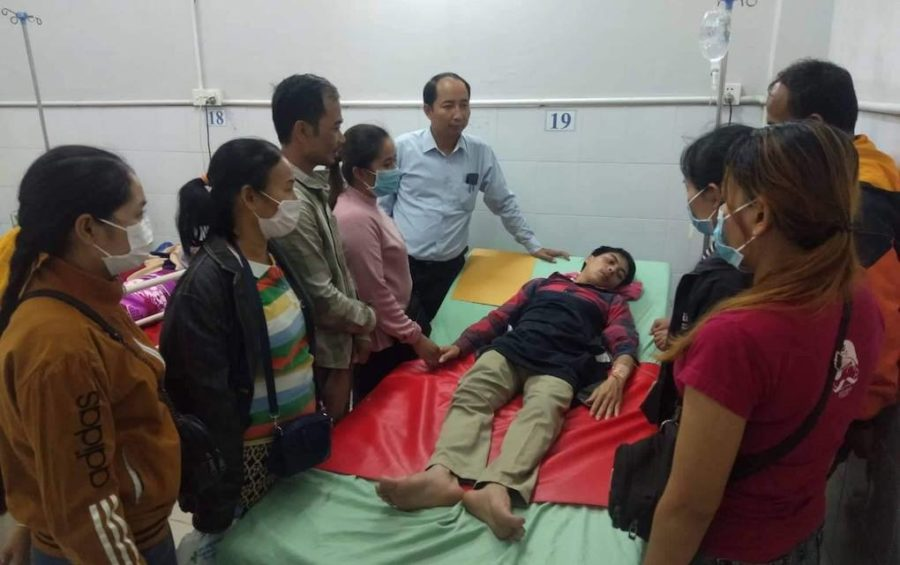 Union leader Ath Thorn visits unionist Soeung Pros in a hospital, in this photograph posted to the Cambodian Labor Confederation's Facebook page on February 11, 2020. Pros was attacked by five unidentified men outside the Phnom Penh factory where he works on February 10.