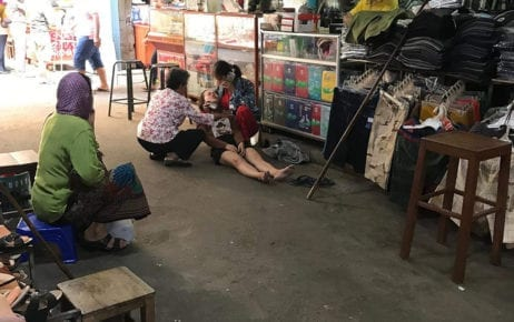 A woman faints in a market in Kampong Cham province, in this photograph posted to the Facebook page LY SokMal on March 8, 2020.