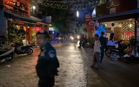 Authorities close down bars on Street 308 in Phnom Penh's Tonle Bassac district on March 17, 2020, following government orders to shut a number of venues in an effort to limit the spread of the Covid-19 respiratory disease (Christopher Rompre)