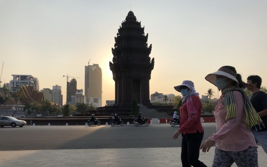 People walk near Independence Monument in Phnom Penh on March 26, 2020. (Matt Surrusco/VOD)