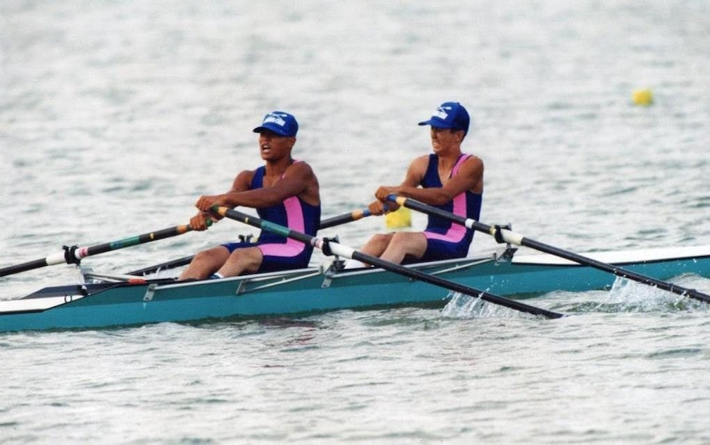Kenji Kuraki (left) and his teammate pull oars in sync during a high school rowing competition. (Courtesy of Kenji Kuraki)