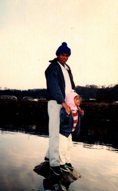 Kenji Kuraki as a child with his father, Roeun Roeum, in Japan (Courtesy of Kenji Kuraki)