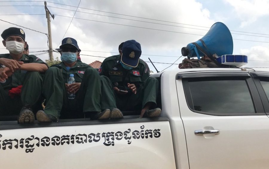 Authorities sit in the bed of a pickup truck in Takeo province in late March 2020 (Ouch Sony/VOD)
