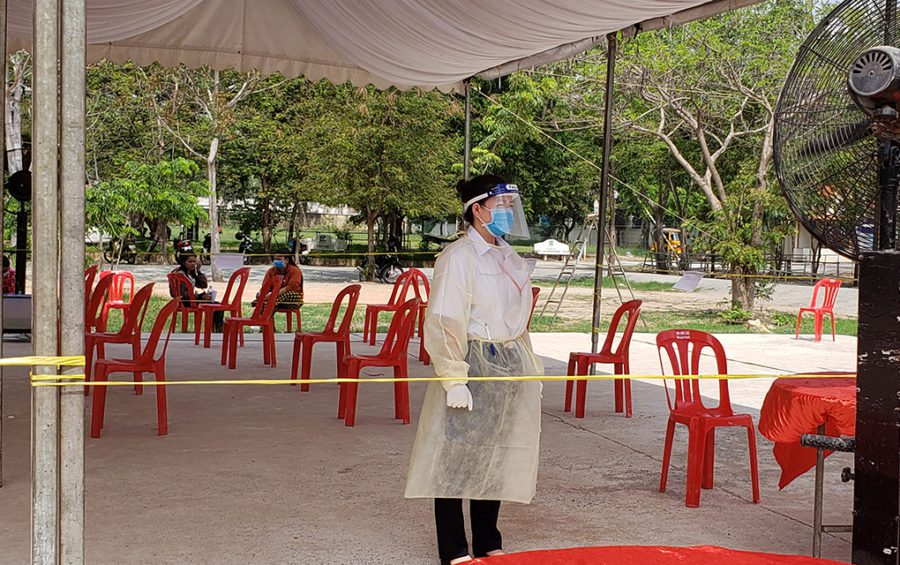 A health worker wears protective equipment during a checkup clinic for garment workers at Chumpouvoan High School in Phnom Penh on April 20, 2020. (Danielle Keeton-Olsen/VOD)