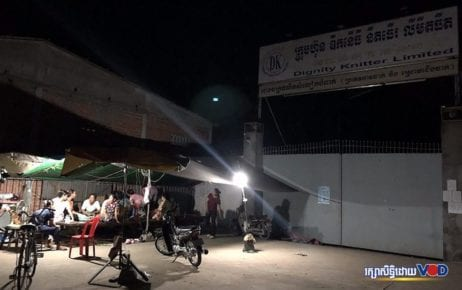Former Dignity Knitter workers rest under a tent in front of the closed garment factory in Takhmao City on May 1, 2020. (Hun Sirivadh/VOD)