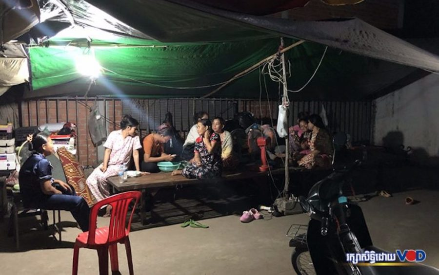 Former Dignity Knitter workers spend their evenings under a tent in front of the closed Takhmao City factory on May 1, 2020. (Hun Sirivadh/VOD)