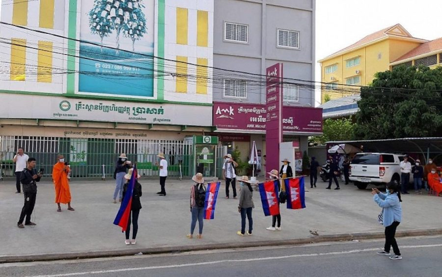 Members of Cambodian youth group Khmer Thavrak protest outside the offices of Prasac and AMK, two of the country's largest microfinance lenders, in Battambang province on May 9, 2020 (Licadho)
