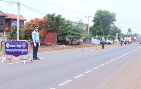 Traffic police stand along National Road 6 in Kampong Thom province on May 13, 2020. (Kampong Thom Provincial Police Headquarters)