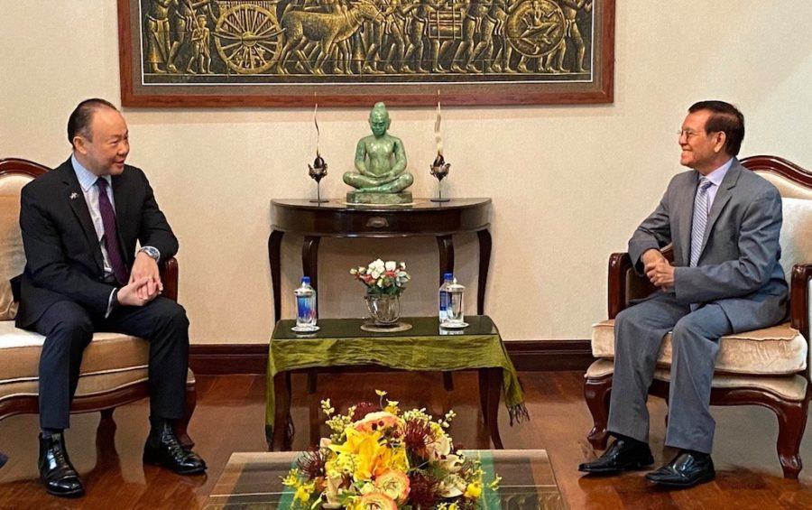 Australian Ambassador Pablo Kang, left, meets with opposition leader Kem Sokha at Sokha's home in Phnom Penh on May 13, 2020, in this photograph posted on Sokha's Facebook page.