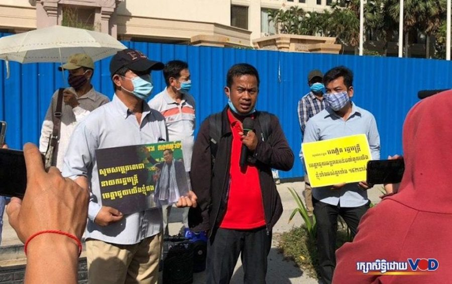 Former employees of The Great Duke Hotel protest in front of the shuttered hotel building in Phnom Penh to demand awarded compensation on May 21, 2020. (Nat Sopheap/VOD)