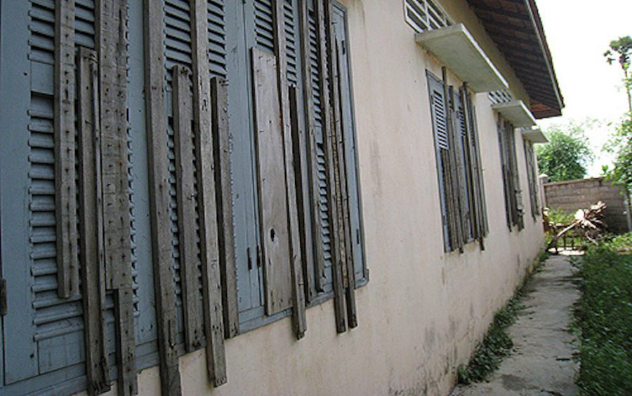 The rear windows of a formerly used building at the Prey Speu detention center in Phnom Penh, which were boarded shut so detainees could not escape through them. (Licadho)