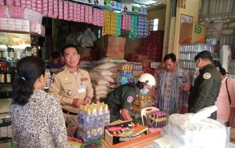 Police collect bottles of a wine product linked to multiple deaths in Banteay Meanchey province on June 11, 2020. (Banteay Meanchey Provincial Police)