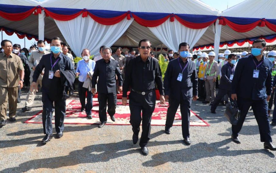 Prime Minister Hun Sen, center, walking at the site of a planned airport in Kandal province on June 22, 2020, in this photograph posted to his Facebook page.