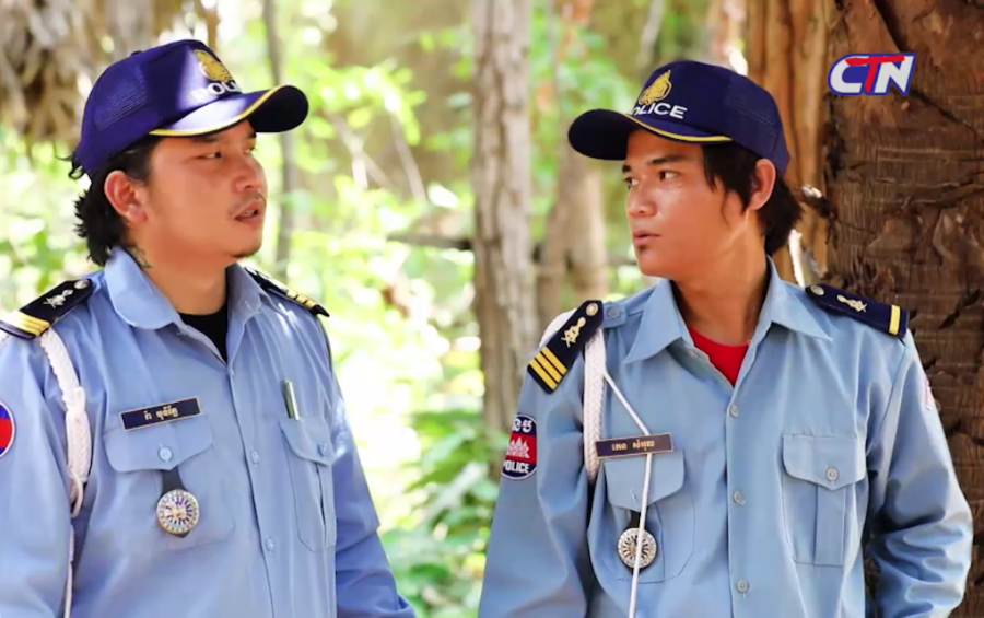 """Actors playing thieves impersonating police officers in a CTN comedy show. The episode, """"Fraudulent Fine,"""" which was released on June 15, 2020, has drawn criticisms from police officers. (CTN/screengrab)"""