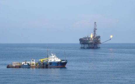 A vessel passes an oil rig platform in the Vung Tau Oil Field off the coast of Vietnam in 2005. (Wikimedia Commons)