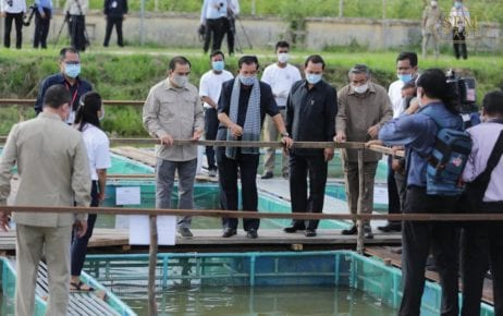 Prime Minister Hun Sen (center) observes fish and frog ponds at the Freshwater Aquaculture Research and Development Center in Prey Veng province in a photo posted to Hun Sen's Facebook page on July 14, 2020.