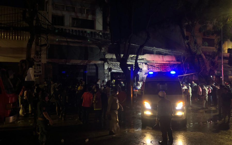 An ambulance and first responders surround the site of an explosion in central Phnom Penh after flames were extinguished on the evening of July 18, 2020 (Matt Surrusco/VOD)