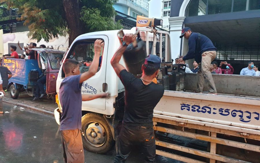Authorities remove gas canisters at the site of an explosion in Phnom Penh on July 18, 2020. (Mech Dara/VOD)