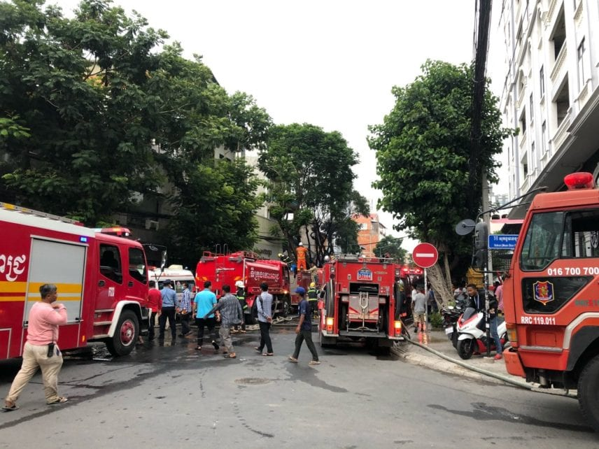 Fire trucks arrive following an explosion in Phnom Penh's Daun Penh district on July 18. (Matt Surrusco)