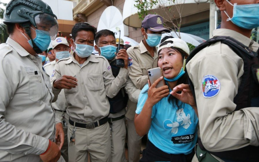 Activist Chhoeun Daravy is surrounded by authorities during a protest outside the Phnom Penh Municipal Court near City Mall on the morning of August 13, 2020 (Licadho)
