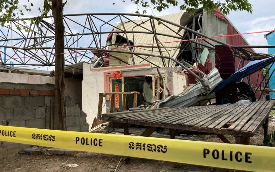 Police tape prevents villagers from entering the front yard of this house in Poipet where five women were killed on August 12, 2020 by a collapsed crane while playing cards. (Ananth Baliga/VOD)